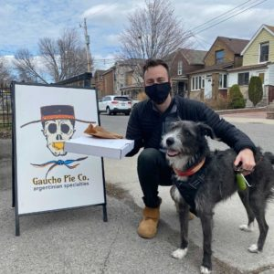 Brian visiting local business Gaucho Pie Co. with his dog